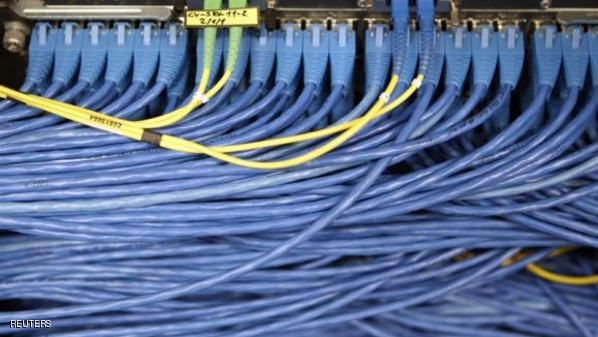 LAN cables are pictured on the Internet server at the EPFL in Ecublens